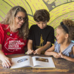 Jen Longdon reading books with school children (Michael Ging)