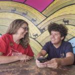 Jen Longdon talking to high school kid (Michael Ging)