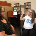 Rep. Jennifer Longdon taking a crash course in American Sign Language with Beca Bailey, June 12, 2019 (Photo: AzCDHH Twitter)
